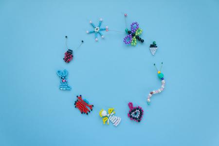 Round frame of childrens crafts on a blue background. Childrens creativity, handmade