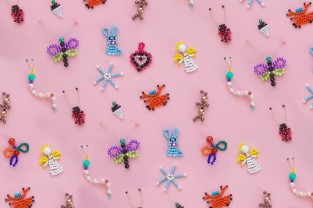 pattern of children's crafts on a pink background. Children's creativity, handmade