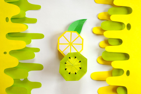 Fruit made of paper. White background. Tropics. Flat lay. Paper Lemon and kiwi. Modern background