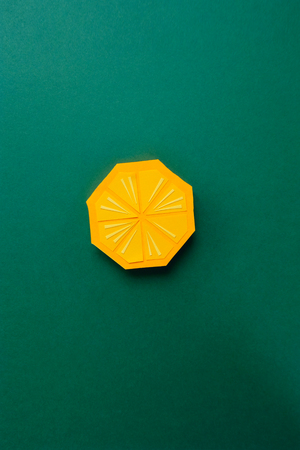 Fruit made of paper. Green background. Theres room for writing. Tropics. Flat lay. Orange. 版權商用圖片