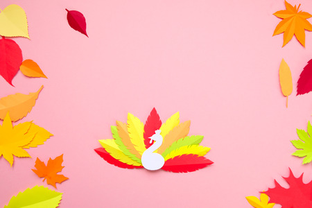 multi-colored turkey tail made of paper on a pink background. Thanksgiving concept 免版税图像