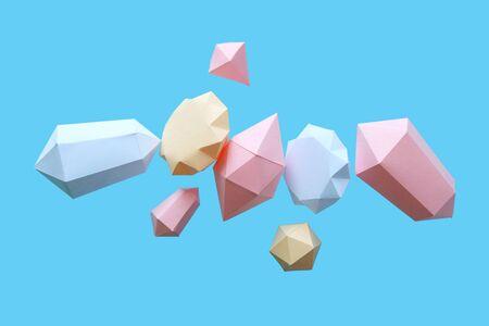 polygonale Rauten aus Papier auf blauem Grund. Schmuck Konzept. Schweben