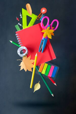 Back to school concept. The various stationery on black background. Education. Levitation