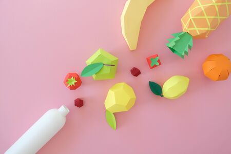 different exotic fruits made of paper on pink background. fruits fly into the bottle. concept Stok Fotoğraf