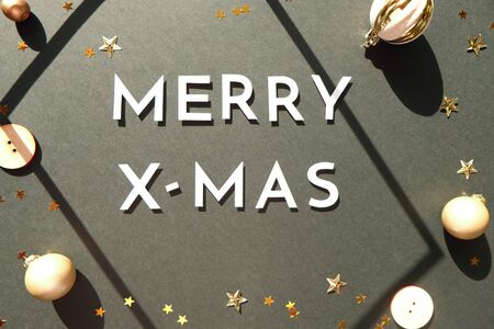 Merry christmas and happy new year wiyh gold decoration on black background colorful glass balls on black background with copy space Stok Fotoğraf