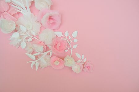 White paper flowers on pink background. Cut from paper.