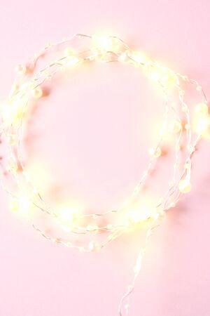 Tiny elegant christmas lights border. Round shape made with rice bulb series on white background. Tenderness Zdjęcie Seryjne