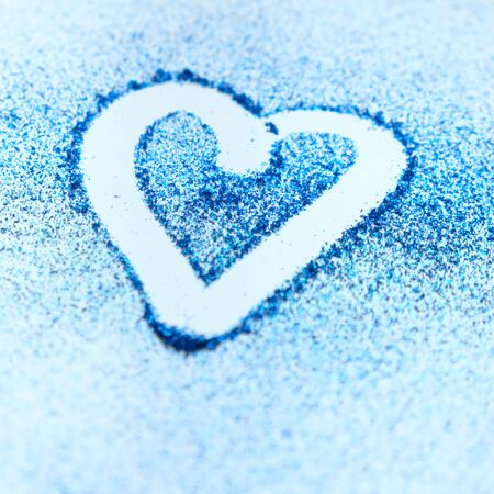 Modern shiny background with heart, color of the year 2020 classic blue. Glitter blue Stock Photo