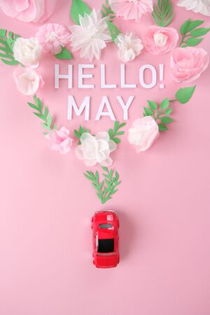 Hello, spring. Red car lucky white and pink flower cut from paper. The concept of spring and travel