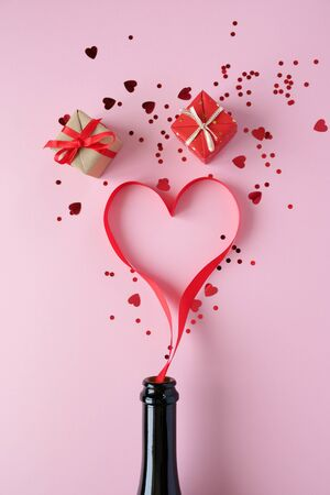 Heart of red ribbon on pink background. Valentine concept