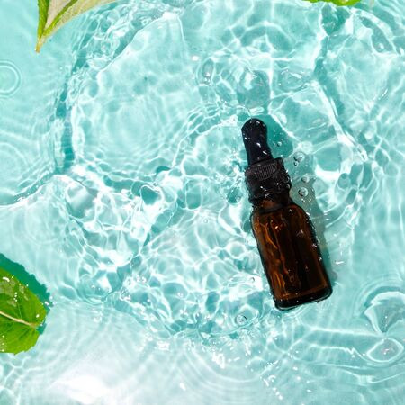 essential oil in water and with mint leaves