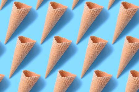 Perspectives of wafer sugar cone. Waffle cone pattern on a blue background Фото со стока