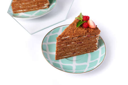 The piece of chocolate cake on white plate. A homemade cake slice. Long format for web 免版税图像