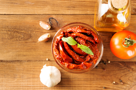sundried: Italian appetizer - sundried tomato in bowl on the wooden table.