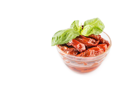 Italian appetizer - sundried tomato in bowl on the white background.