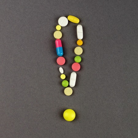 antibiotic pink pill: Exclamation point created from colored pills. Medical concept.