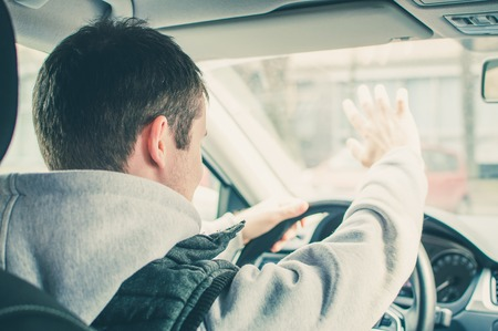 road rage: Furious and reckless driver. Danger driving concept. Stock Photo