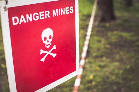 Warning sign - Danger mines on a forest. Zdjęcie Seryjne