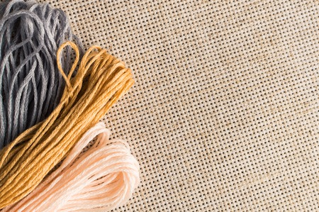 Accessories for hobbies: different colors of thread for embroidery. Stock Photo