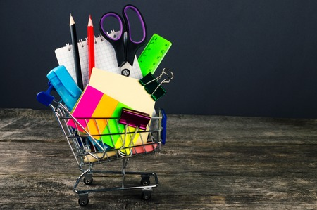 Shopping cart with school supplies. Back to school. Stock Photo