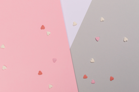 Paper flat composition with pink and grey background for Valentines day.