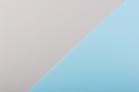 Paper flat composition with blue and grey background.