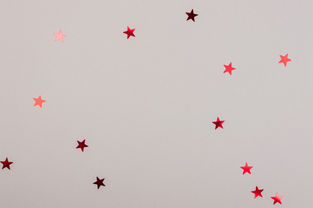 Paper flat composition with stars on the grey background for holiday. Standard-Bild