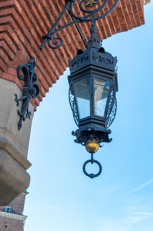 Lamp on the old building in Krakow. Square of market Standard-Bild