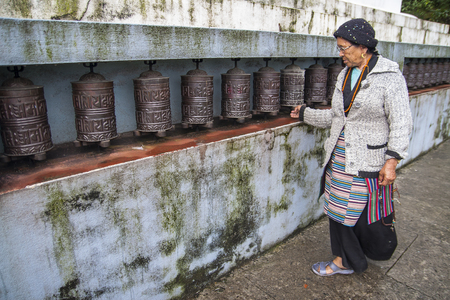 rotational: JIRI, NEPAL – CIRCA OCTOBER 2013: prayer wheel used in Tibetan Buddhism to the rotational axis of the cylinder inscribed with mantras surface circa October 2013 in Jiri.