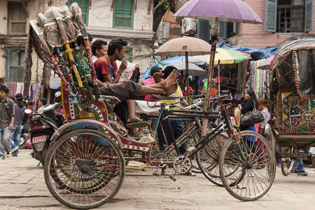 means of transport: KATHMANDU, NEPAL – CIRCA OCTOBER 2013: rickshaw is a very popular means of public transport in cities in Nepal circa October 2013 in Kathmandu.