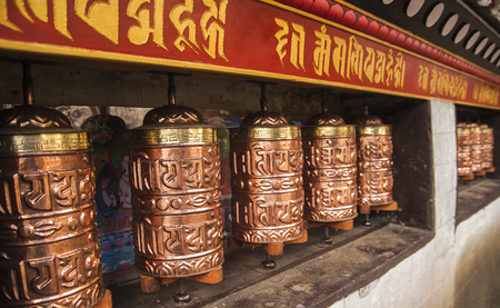 rotational: PANGBOCHE, NEPAL - CIRCA OCTOBER 2013: prayer wheel used in Tibetan Buddhism to the rotational axis of the cylinder inscribed with mantras surface circa October 2013 in Pangboche. Editorial