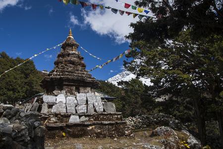 mani: PANGBOCHE, NEPAL: Buddhist stupa in Pangboche circa October 2013 in Pangboche. Stock Photo