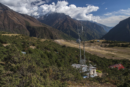 airstrip: SYANGBOCHE, NEPAL - CIRCA OCTOBER 2013: Syangboche Airport also known as Syangboche Airstrip is an unpaved airstrip serving the village of Namche Bazaar, in Solukhumbu district, Nepal circa October 2013 in Syangboche. Stock Photo
