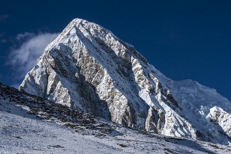 sherpa: KALA PATTHAR, NEPAL - CIRCA OCTOBER 2013: view of Pumori from Kala Patthar circa October 2013 in Kala Patthar. Stock Photo
