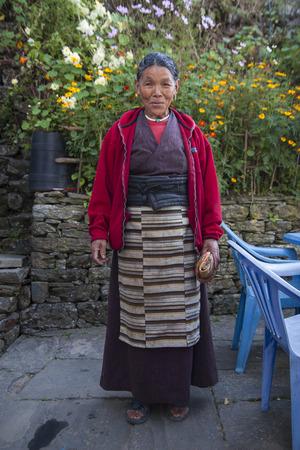 sherpa: CHHEPLUNG, NEPAL - CIRCA OCTOBER 2013: Nepalese woman circa October 2013 in Chheplung.