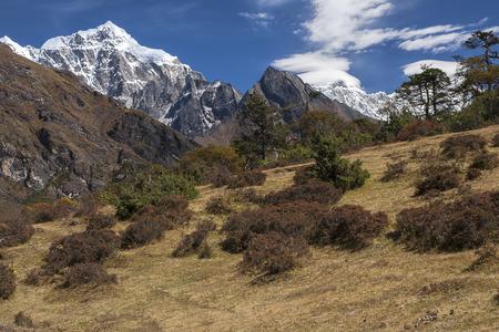 sherpa: NAMCHE BAZAR, NEPAL - CIRCA OCTOBER 2013: view of the Himalayas from near Namche Bazaar circa October 2013 in Namche Bazar.