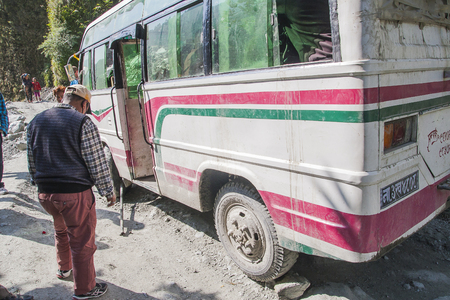 bumpy road: KALAPANI, NEPAL - CIRCA NOVEMBER 2013: failure of the bus on a bumpy road Nepalese circa November 2013 in Kalapani.
