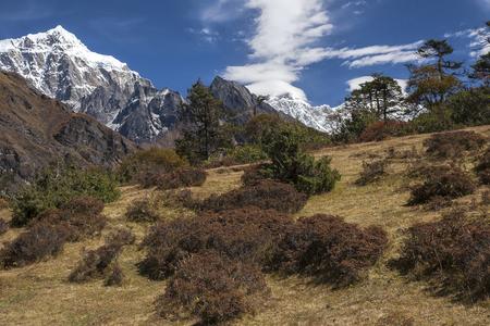 mani: NAMCHE BAZAR, NEPAL: view of the Himalayas from near Namche Bazaar circa October 2013 in Namche Bazar. Stock Photo