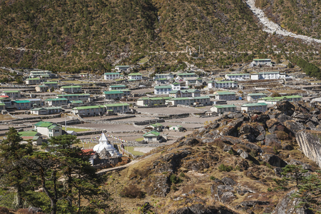 mani: KHUNDE, NEPAL: view of the village of Khumjung in the Himalayas circa October 2013 in Khunde. Stock Photo
