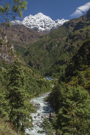 CHHEPLUNG, NEPAL: view of the Himalayas in the way of Chheplung to Namche Bazar circa October 2013 in Chheplung. Stock Photo