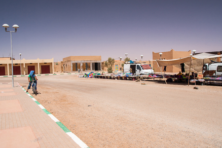erg: HASSILABIED, MOROCCO - CIRCA SEPTEMBER 2014: view of the village Hassilabied near Merzouga, Erg Chebbi sand dunes circa September 2014 in Hassilabied.