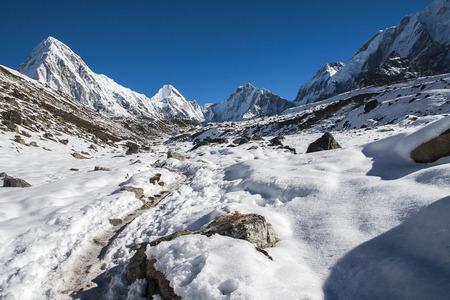 sherpa: GORAKSHEP, NEPAL: view of Pumori, Lingtren and Khumbutse circa October 2013 in Gorakshep.
