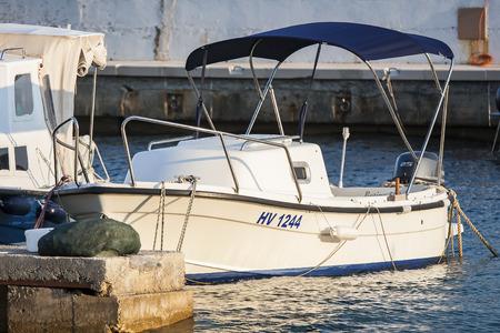 HVAR, CROATIA – CIRCA SEPTEMBER 2016: motor boat in the harbor in the village of Sveta Nedilja on the island of Hvar circa September 2016 in Hvar.