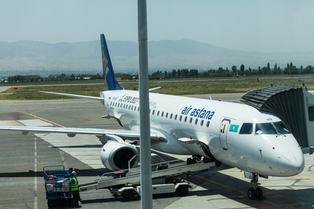 DUSHANBE, TAJIKISTAN - CIRCA JUNE 2017: Air Astana plane at Dushanbe airport circa June 2017 in Dushanbe. Editorial