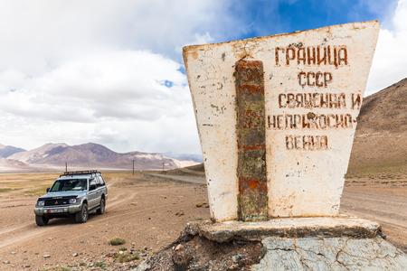 RANGKUL, TAJIKISTAN - CIRCA JUNE 2017: Off-road vehicle at  Rangkul Lake in Tajikistan circa June 2017 in Rangkul.