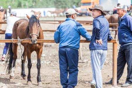 KARAKOL, KYRGYZSTAN - CIRCA JUNE 2017: Weekly Sunday animal market in Karakol city near the eastern tip of Lake Issyk-Kul in Kyrgyzstan circa June 2017 in Karakol.