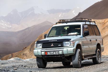 AK-BAITAL, TAJIKISTAN - CIRCA JUNE 2017: Off-road vehicle at  Ak-Baital Pass in Tajikistan circa June 2017 in Ak-Baital.
