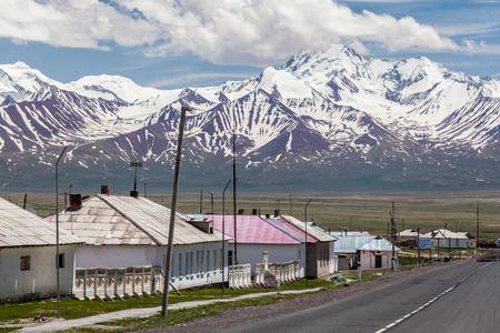 SARY-TASH, KYRGYZSTAN - CIRCA JUNE 2017: View on Sary-Tash a village and major crossroads in the Alay Valley of Osh Region, Kyrgyzstan circa June 2017 in Sary-Tash.