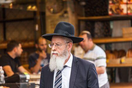 JERUSALEM, ISRAEL - CIRCA MAY 2018: Israelis at Mahaneh Yehuda Market circa May 2018 in Jerusalem.