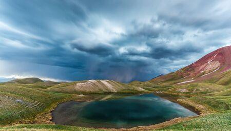 Beautiful view of Tulpar Kul lake in Kyrgyzstan during the storm